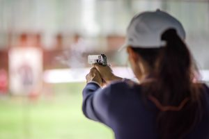 woman holding a handgun at gun range for License To Carry